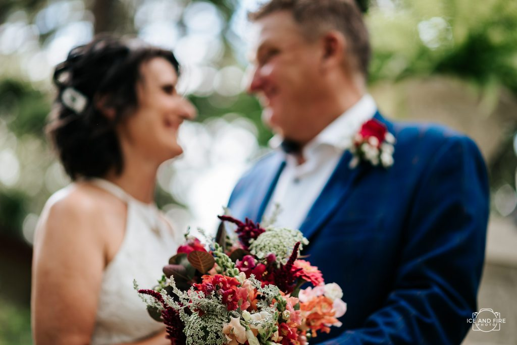 married couple with flowers